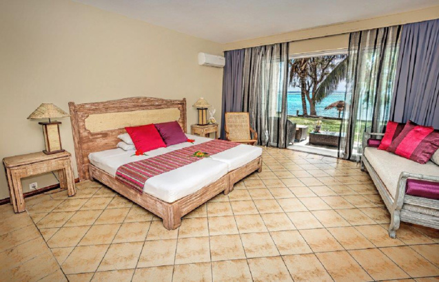 L'une des chambres de luxe du Cotton Bay Resort & Spa